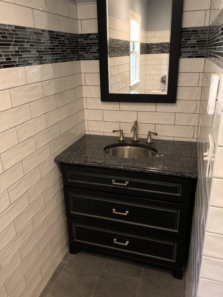 Bath Remodeling Subway Tile Dark Cabinet